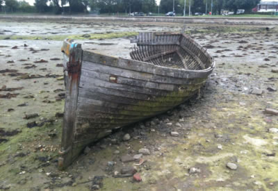 Abandoned Boats - A Wooden Boat abandoned in a creek